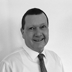 Image description: Black and white photo of Richard Schildwachter, Technical Service Manager at Separators, Inc. In a white button-down with a tie.