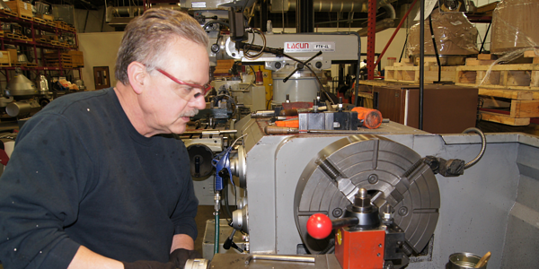 Image of a man working on a centrifuge part