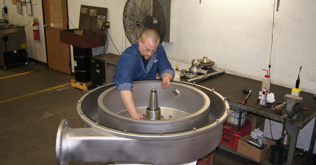 Image of a man working on a centrifuge bowl